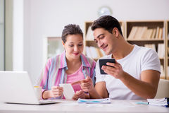 The young family discussing family finances Royalty Free Stock Images