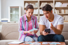 The young family discussing family finances. Young family discussing family finances Royalty Free Stock Image
