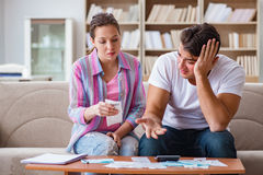 The young family discussing family finances Stock Images