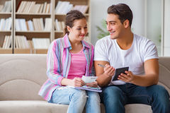 The young family discussing family finances. Young family discussing family finances Stock Image