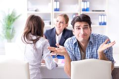 Young family dissappointed at high interest mortgage rate in ban. K stock photography