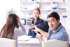 Young family dissappointed at high interest mortgage rate in ban. K royalty free stock photos