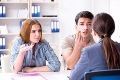 Young family dissappointed at high interest mortgage rate in ban. K royalty free stock image