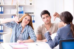 Young family dissappointed at high interest mortgage rate in ban. K royalty free stock photo