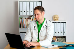 Young family doctor in his office Stock Images