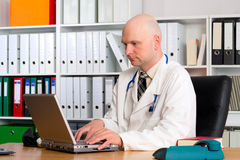 Young family doctor in his office Royalty Free Stock Images