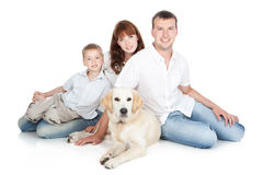 A young family with a dog Royalty Free Stock Images