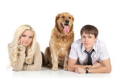 Young family with a dog on floor Stock Photography