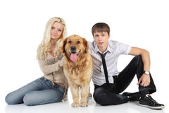 A young family with a dog sitting on floor Stock Photos