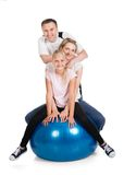 Young family doing fitness together Stock Photos