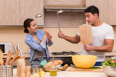The young family doing funny fight at kitchen Royalty Free Stock Photos