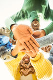 Young family doing a head circles and joining their hands Royalty Free Stock Photo