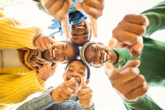 Young family doing a head circles and pointing the camera Royalty Free Stock Image