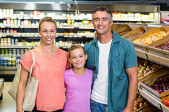 Young family doing some shopping Royalty Free Stock Images