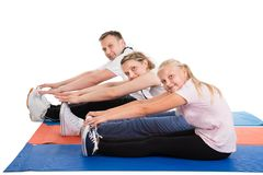 Young family doing stretching exercises Royalty Free Stock Image
