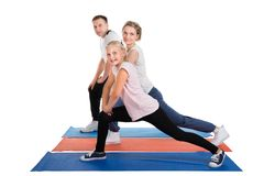 Young family doing stretching exercises Royalty Free Stock Photo