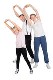 Young Family Doing Stretching Exercises Royalty Free Stock Photography