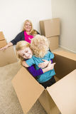Young Family In Empty Room Playing With Moving Boxes Royalty Free Stock Image
