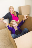 Young Family In Empty Room Playing With Moving Boxes Royalty Free Stock Photography