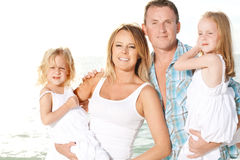 Young family enjoy sunny day at the beach. Stock Photography