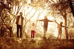 Young family enjoying in autumn day. Family spending day in park royalty free stock photo