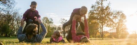Young family enjoying in autumn park stock photos