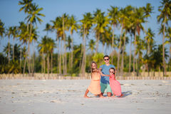 Young family enjoying beach summer vacation Stock Photography