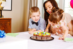 Young family enjoying birthday candles Royalty Free Stock Images