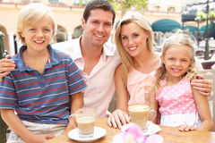 Young Family Enjoying Cup Of Coffee Stock Photos