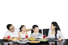 Young family enjoying lunch together on studio Royalty Free Stock Images