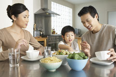 Young Family Enjoying Meal Royalty Free Stock Image