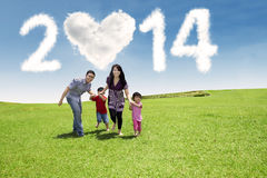 Young family enjoying new year day Royalty Free Stock Photos