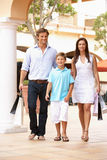 Young Family Enjoying Shopping Trip. Together Stock Image