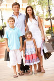 Young Family Enjoying Shopping Trip Royalty Free Stock Photo