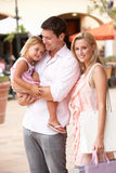Young Family Enjoying Shopping Trip. Together Royalty Free Stock Photo