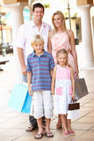Young Family Enjoying Shopping Trip Stock Photo