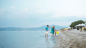Young family enjoying a summer at the seaside Stock Photography