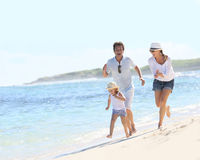 Young family enjoying their summer holidays Royalty Free Stock Photo
