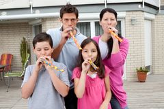 Young family enjoying themselves in their backyard Royalty Free Stock Image