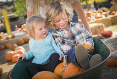 Young Family Enjoys a Day at the Pumpkin Patch. Adorable Young Family Enjoys a Day at the Pumpkin Patch Royalty Free Stock Photo
