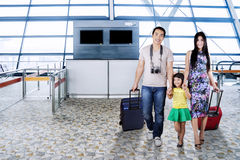 Young family entering into the airport terminal Royalty Free Stock Photo