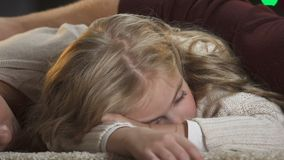 Young family falling asleep under x-mas tree waiting for Santa Claus, magic time. Stock footage stock video