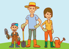 A young family, father, mother and child are working in the garden. Royalty Free Stock Photos