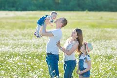 Young family in a field of flowers daises chamomile anjoy spa life happy together with cute faces in a village rustic motion stock photo