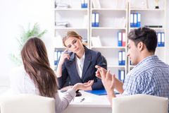 The young family filing divorce papers with lawyer. Young family filing divorce papers with lawyer stock image
