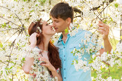 Young family in flower garden Stock Photo