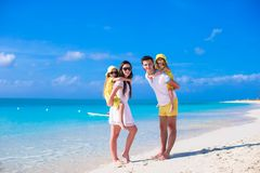 Young family of four on beach vacation Stock Images