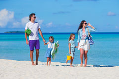 Young family of four on beach vacation Royalty Free Stock Images