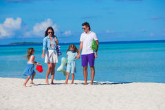 Young family of four on beach vacation Stock Image