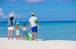 Young family of four on beach vacation Royalty Free Stock Photography